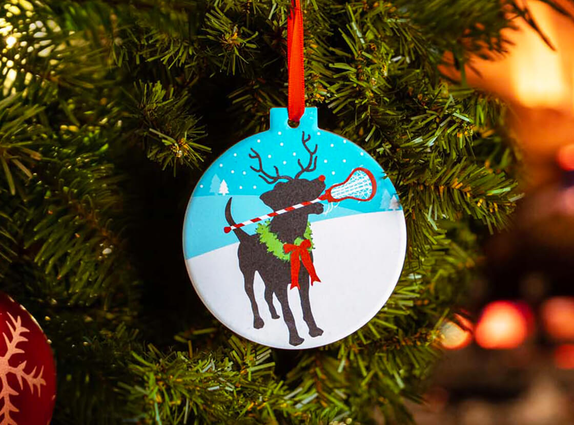 Jingles the Lax Reindeer Dog Round Ceramic Ornament